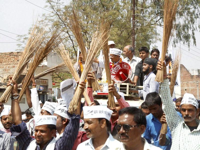 AAP convener Arvind Kejriwal waves at his supporters during his road show in Varanasi. (PTI Photo)
