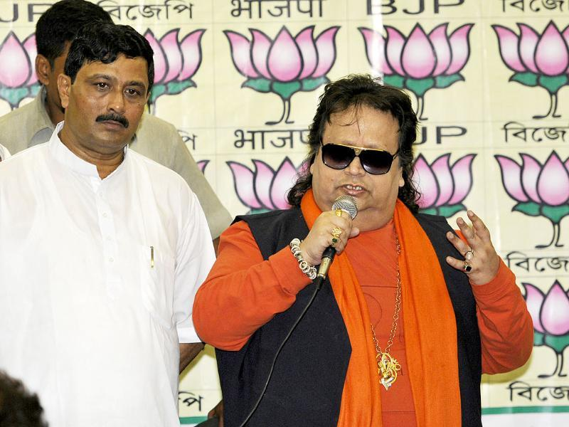 Bappi Lahiri, BJP candidate from Sreerampore constituency (Hooghly district) for Lok Sabha election with BJP state president Rahul Sinha in Kolkata. (Subhankar Chakraborty/HT photo)