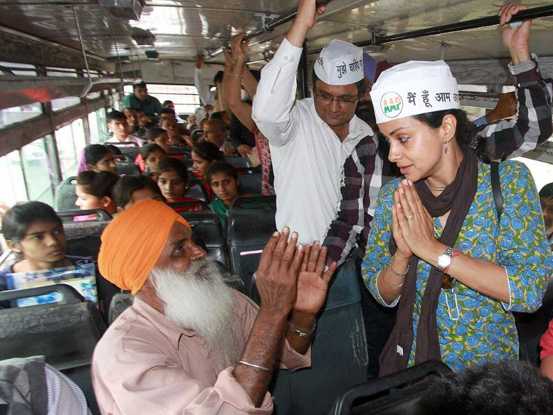 Aam Aadmi Party candidate Gul Panag with people in a public transport bus during her election campaign in Chandigarh. (PTI photo)