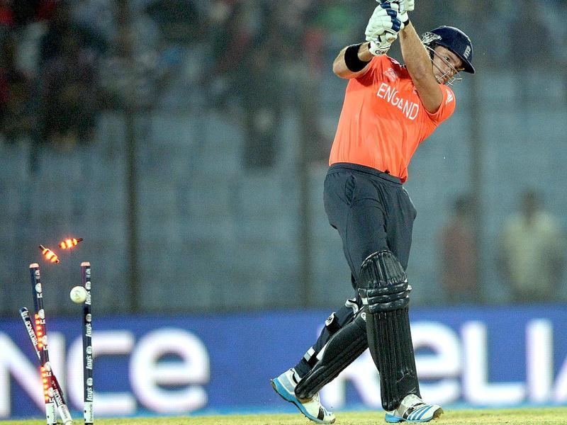 England's Michael Lumb is clean bowled by Sri Lanka's Nuwan Kulasekara during their ICC World Twenty20 match at the Zahur Ahmed Chowdhury Stadium in Chittagong. (AFP Photo)