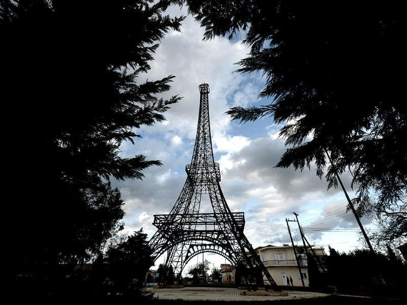 Greece: A 26-meter-high replica of the Eiffel Tower made by Greek doctor and sculptor Harris Fournarakis stands at a square of the entrance of Filiatra village, some 280 kilometers south west of of Athens. (AFP)