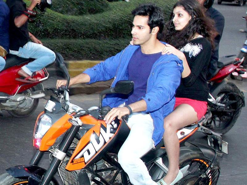 Lucky shot: Varun Dhawan is seen with the winner of a contest held during Main Tera Hero promotions.