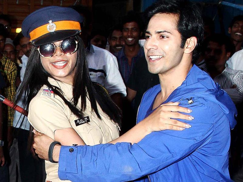 Shake a leg: Varun Dhawan dances with the officer.