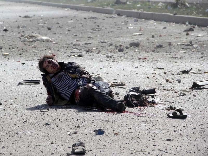 An injured man is seen on the ground following a reported air strike by government forces on April 2, 2014, in the Sakhur neighborhood of the northern Syrian city of Aleppo. (AFP Photo)