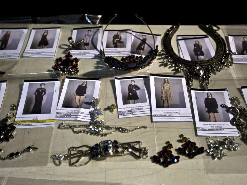 Photographs of outfits and jewelry sit backstage during Mexican Fashion Week in Mexico City. (AP)