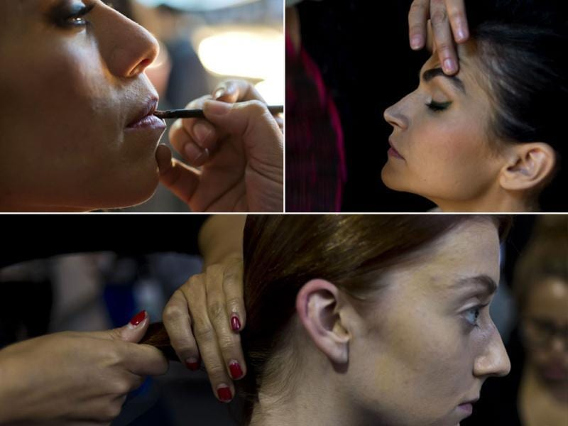 Models during makeup session on the backstage of the Mexican Fashion Week in Mexico City (left to right). (AFP)