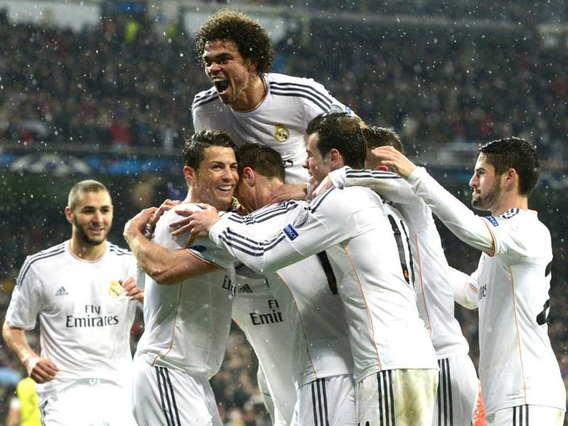 Real Madrid's Cristiano Ronaldo (L) celebrates with teammates after scoring during the UEFA Champions League quarterfinal match against Borussia Dortmund at the Santiago Bernabeu stadium in Madrid. (AFP Photo)