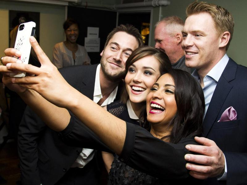 The bend-it-to-pose selfie - Yes, that was a Parminder Nagra joke. The actress strikes the perfect happy selfie pose with Ryan Eggold, Megan Boone and Diego Klattenhoff ahead of a shoot. (AP Photo)