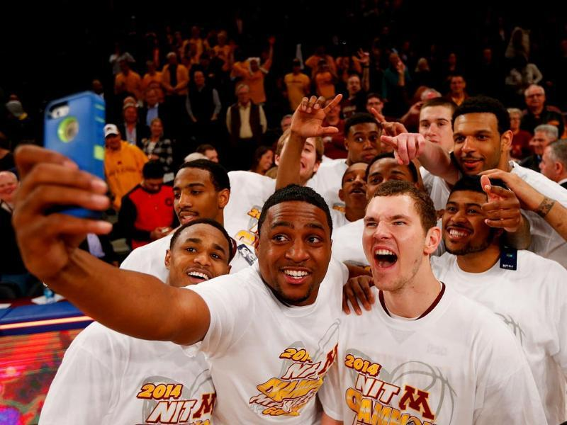 The winners selfie - Minnesota Golden Gophers celebrate after defeating the Southern Methodist Mustangs to win the 2014 NIT Championship in NY. Just look at those grins. (AFP Photo)