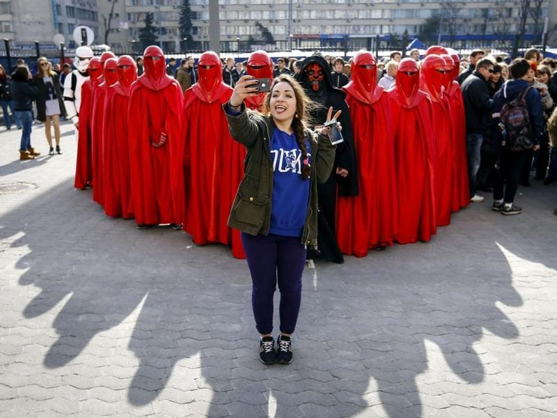 The look-there's-something-cool-happening-behind-me selfie - She's standing in front activists from the Internet Party of Ukraine during a rally. And there party leader is called Darth Vader. Beat that. (Reuters Photo)