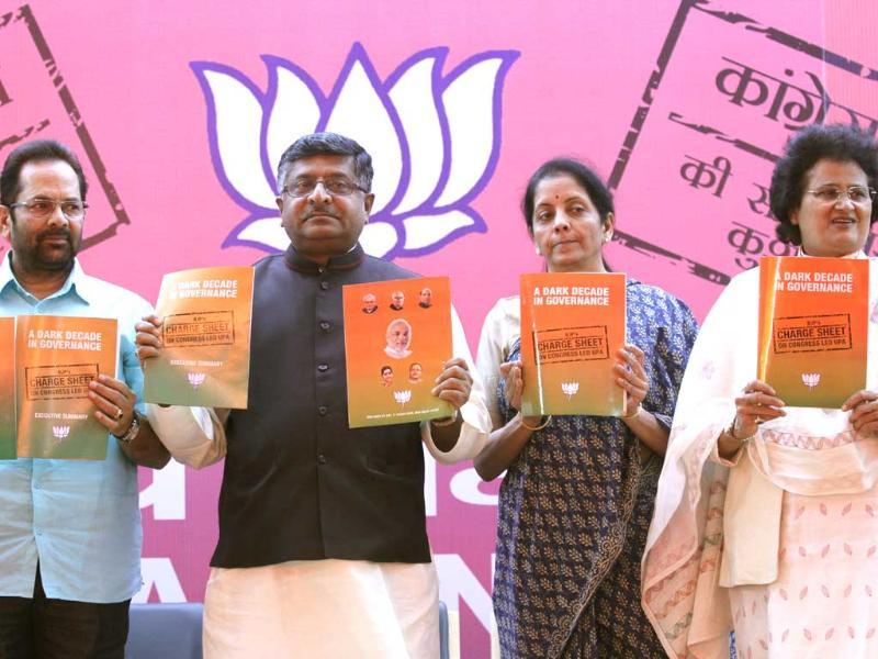 BJP leaders Ravishankar Prasad, Mukhtar Abbas Naqvi, Nirmala Sitharaman and Arti Mehra releasing the party's chargesheet against Congress in New Delhi. (Virendra Singh Gosain/HT photo)