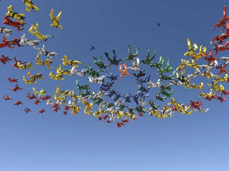 Skydivers form a missing man formation in Eloy, Arizona. (Reuters Photo)