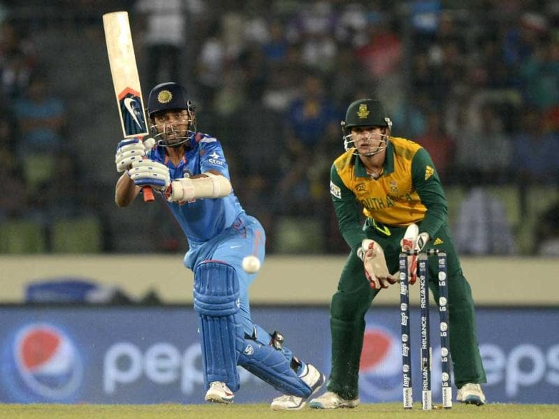 Ajinkya Rahane (L) plays a shot as South Africa's Quinton de Kock (R) looks on during their ICC World Twenty20 match at the Sher-e-Bangla National Cricket Stadium in Dhaka. (AFP Photo)