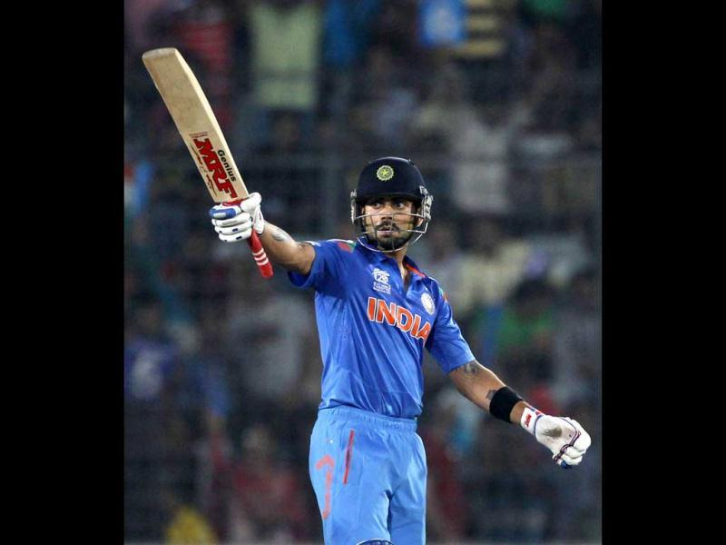 Virat Kohli celebrates after scoring a half century against South Africa during their ICC World Twenty20 match at the Sher-E-Bangla National Cricket Stadium in Dhaka. (Reuters Photo)