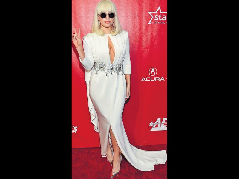 This is one of our favourite looks, as there's no one else who can dare to make risqué look classy. With a navel-deep keyhole cut at the front, Gaga made a bold statement at a ­charity red carpet event. Her perfect bangs added to the chic look.