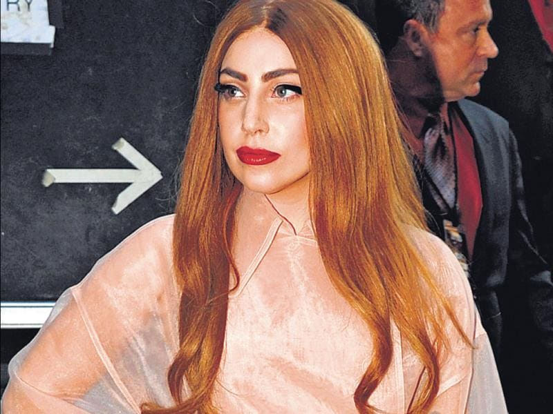 The singer was spotted in New York recently in a powder pink dress, which showed off her feminine taste. With hair a mix of strawberry blonde and copper brown, and a fairy-organza feel to the dress, Gaga did pretty with a vengeance.