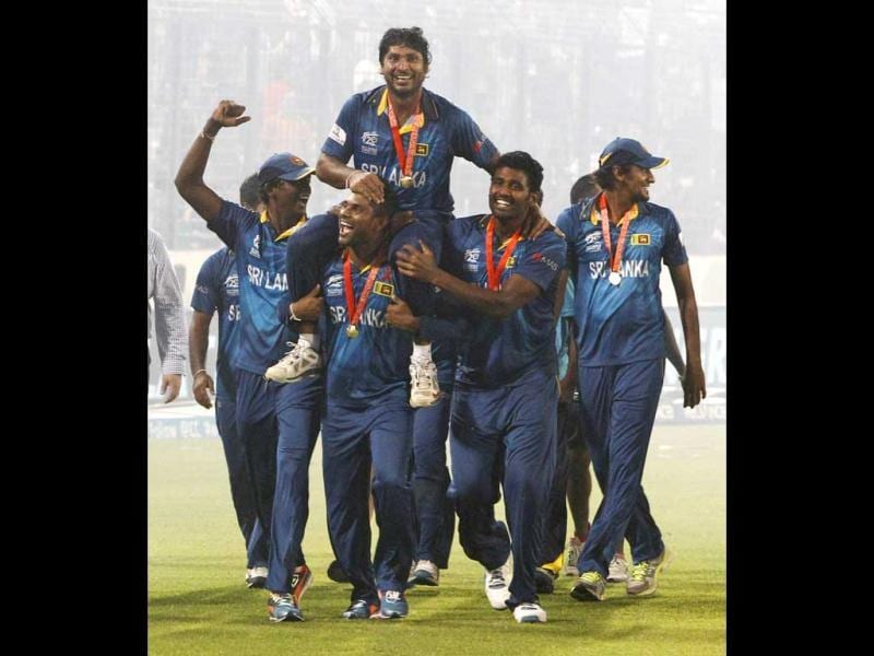 Sri Lanka's players lift Kumar Sangakkara, as they acknowledge the crowd after their win over India in the ICC Twenty20 World Cup final match in Dhaka. (AP Photo)