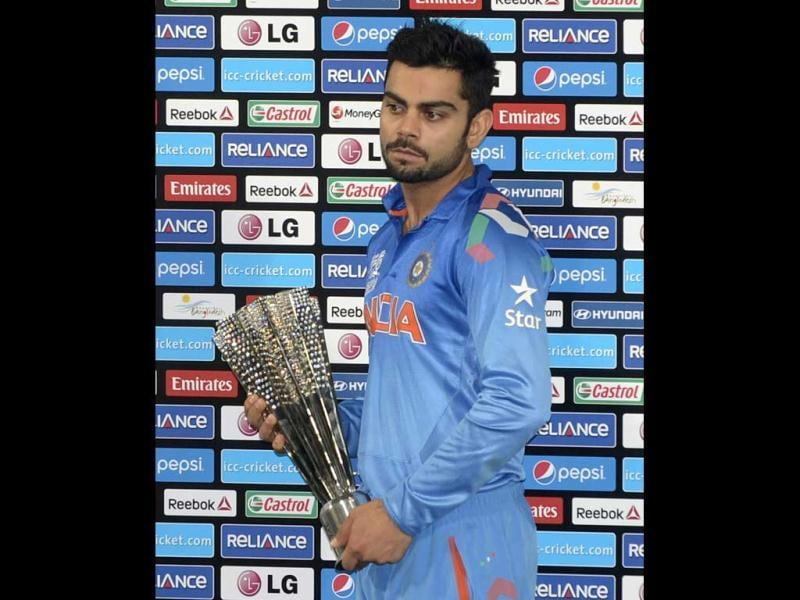 Virat Kohli poses with the Man of the Series trophy following the ICC World Twenty20 final match against Sri Lanka at the Sher-e-Bangla National Cricket Stadium in Dhaka. (AFP Photo)
