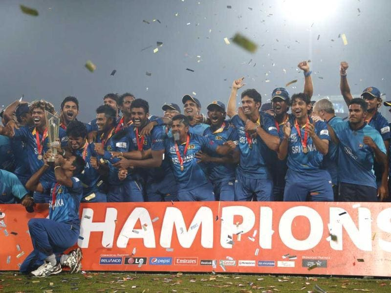 Sri Lankan players and support staff celebrate with the trophy after their win over India in the ICC Twenty20 World Cup final match in Dhaka. (AP Photo)