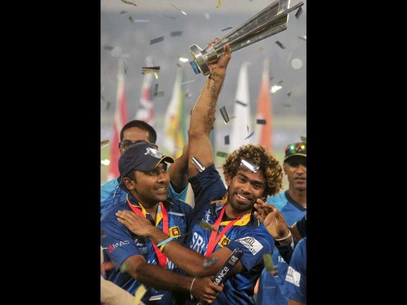 Sri Lanka's players celebrate with the trophy after beating India to win the ICC Twenty20 World Cup at the Sher-E-Bangla National Cricket Stadium in Dhaka. (Reuters Photo)