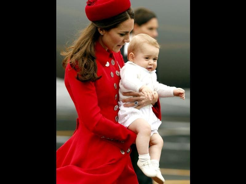 Catherine, the Duchess of Cambridge, holds her son Prince George after disembarking their plane with her husband Britain's Prince William in Wellington. (Reuters Photo)