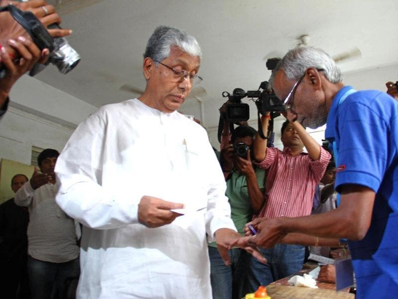 Tripura CM Manik Sarkar gets his finger marked with ink by an election official as he votes at a polling station in Agartala, Tripura. (AFP photo)