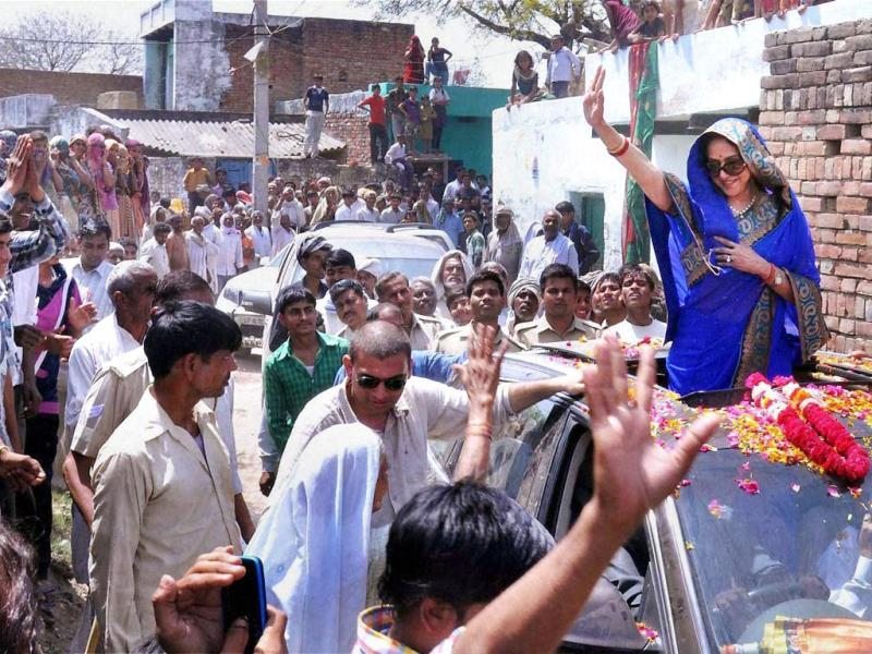 It's raining Bollywood stars on poll street. Politicians, aware of the huge impact that celebrities have on people, have roped in several film and sports personalities to help them campaign for the ongoing general elections. Hema Malini waves to crowds in Mathura. (HT PHOTO)