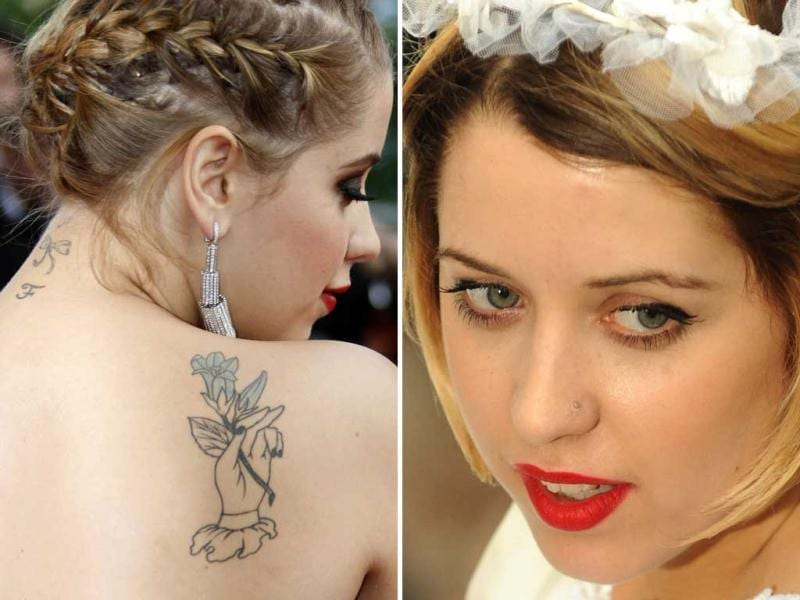 Model and socialite Peaches Geldof arrives for the screening of the film The Imaginarium of Doctor Parnassus at the 62nd Cannes Film Festival in this 2009 file photo (left) and attends the UK premiere of Bruno at Empire Leicester Square Central London in this 2009 photo. (Reuters and AFP)