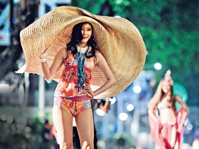 A model presents creations on a street during the Orchard Fashion Runway 2014 in Singapore.