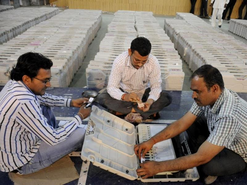 Election officials checking electronic voting machines to be used for the forthcoming Lok Sabha polls in Gurgaon. (Parveen Kumar/HT photo)
