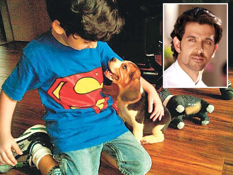 Seen here is Hrithik Roshan's son, Hrehaan, with their dog, Paris.