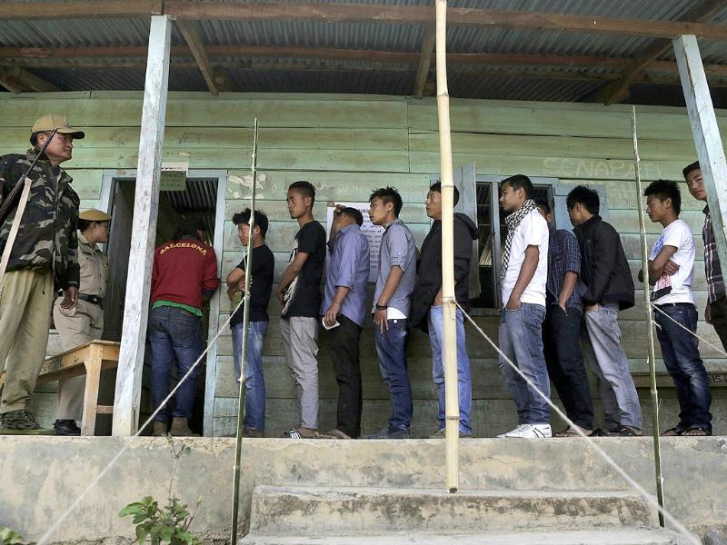 People stand in line to cast their votes at a voting center in Senapati, Manipur (AP Photo)