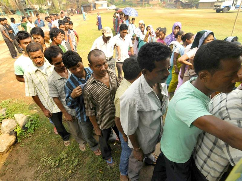 Voters stand in a queue to cast their ballots at a polling station in Harleybagan village, Meghalaya (AFP Photo)