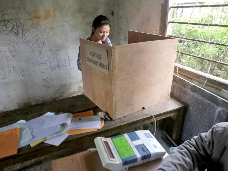 A girl casts her vote at a voting center in Kalapahar, Manipur state (AP Photo)
