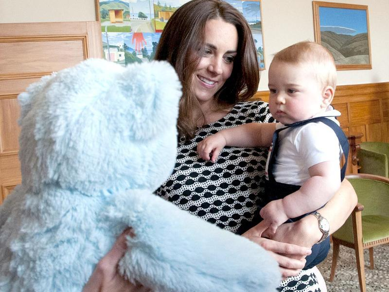 Prince George plays with a large soft bear during a visit to the Plunket nurse and parents group in Wellington. (AFP photo)