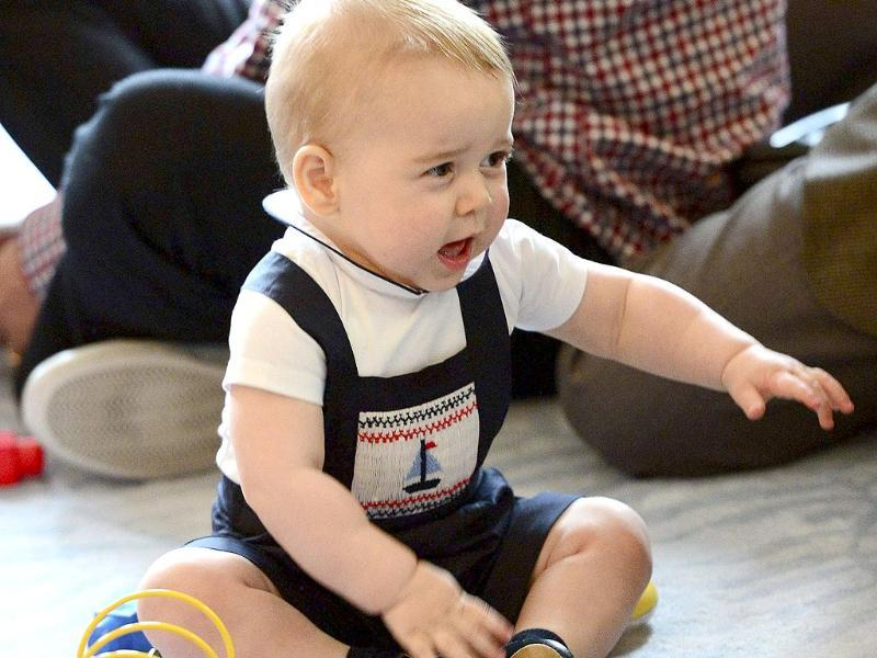 Prince George plays at a Plunket play group event at in Wellington, New Zealand. (Reuters photo)