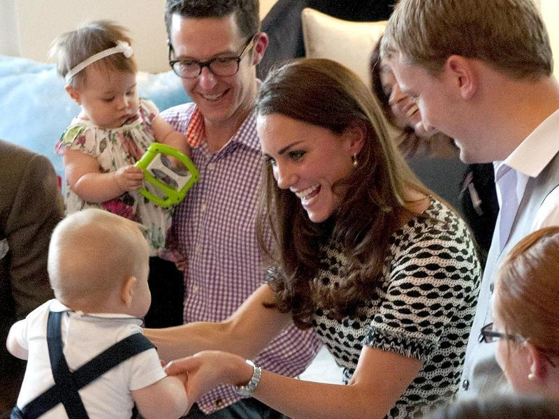 Prince George plays with his mother during a visit to the Plunket nurse and parents group in Wellington. (AFP photo)
