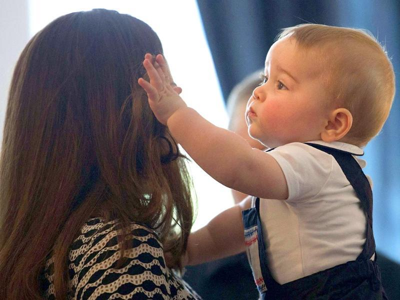 Catherine, Duchess of Cambridge, holds her son Prince George during a Plunket nurse and parents' group event in Wellington. (Reuters photo)