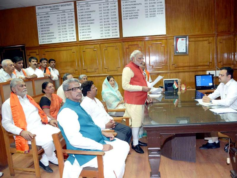 Narendra Modi hands over his nomination papers to the collector at Vadodara.