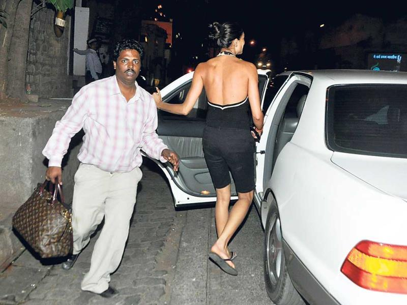 Sushmita Sen, wearing a hot, backless number, made a hurried exit on Tuesday night after noticing our photographer outside a Bandra eatery. Her assistant jumped into action, her bag in his hand, and tried to block the view.