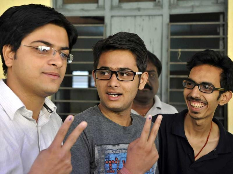 Young voters pose at a polling booth after voting in New Delhi. (HT Photo/Sonu Mehta)