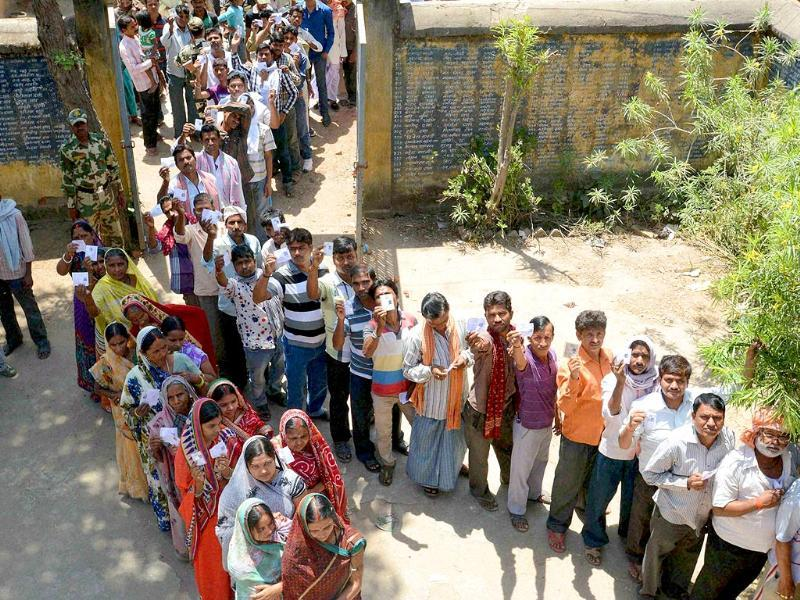 People wait in long queues to to cast their votes for Lok Sabha polls in Gaya. (PTI Photo)