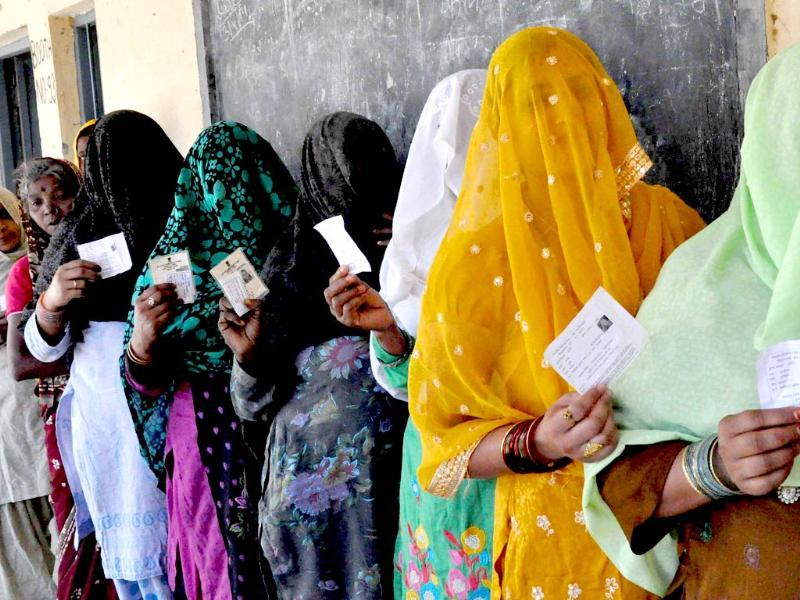 Women voters wait to cast votes for Lok Sabha elections in Faridabad. (PTI Photo)