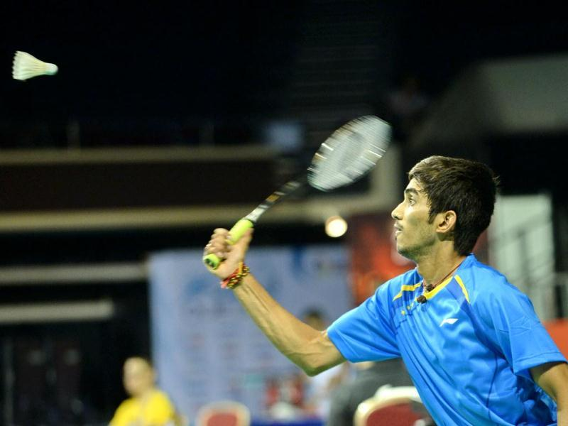 K Srikanth reaches for a return shot against Hu Yun of Hong kong during the OUE Singapore Open badminton tournament men single quarterfinal in Singapore. (AFP Photo)