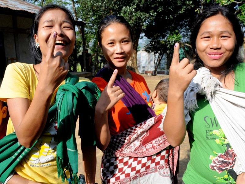 Young girls show their marked fingers after casting votes for Lok Sabha polls at a polling station in Aizawl, Mizoram. (PTI Photo)
