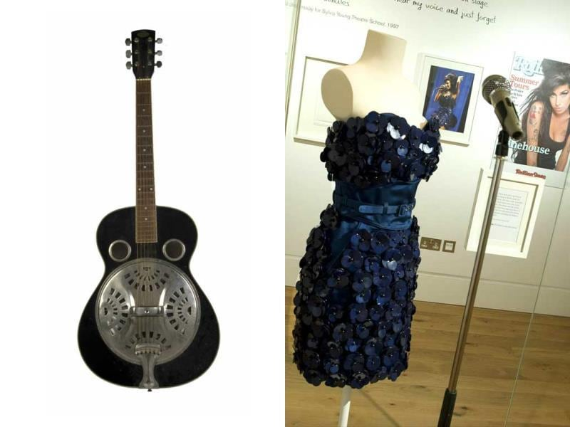 Her most treasured guitar and the Luella Bartley dress worn by Winehouse at Glastonbury 2008. (AFP)