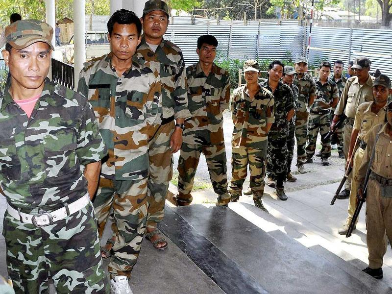 KLNF cadres wait in a queue to cast their postal ballots for the Lok Sabha polls at a designated camp at Taralangso under Karbi Anglong district of Assam. (PTI photo)