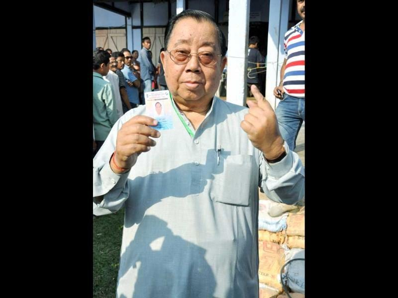 Congress candidate Biren Singh Engti shows his ink marked finger after casting his vote for the Lok Sabha polls at Diphu in Karbi Anglong district of Assam. (PTI photo)