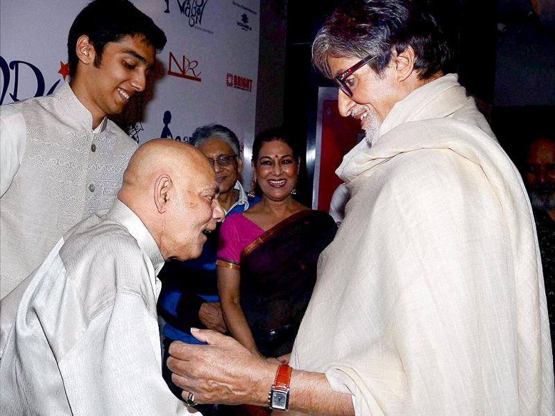 Amitabh Bachchan with Anwar Ali (brother of comedian Mehmood) at special screening of film Bombay to Goa as tribute to 10th death anniversary of actor Mehmood at PVR screens in Juhu on Saturday. (PTI Photo)