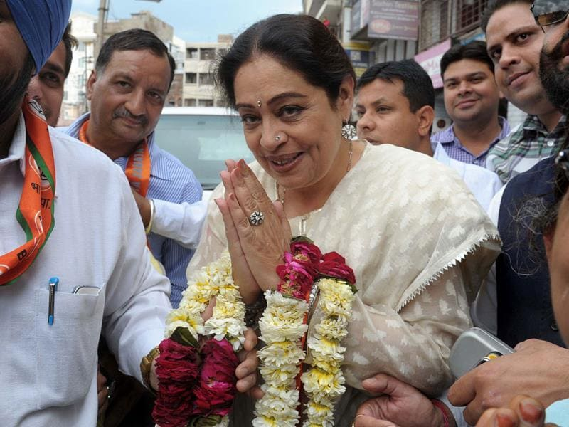 Actor and BJP candidate from Chandigarh, Kirron Kher greets during an election campaign in favour of Arun Jaitley, BJP parliamentary seat candidate from Amritsar. (AFP)